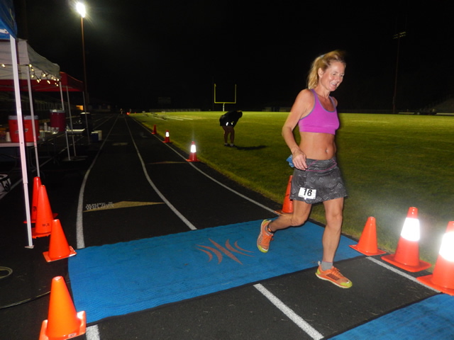 3:30 am... with runners orbiting the track at wildly varying speeds.