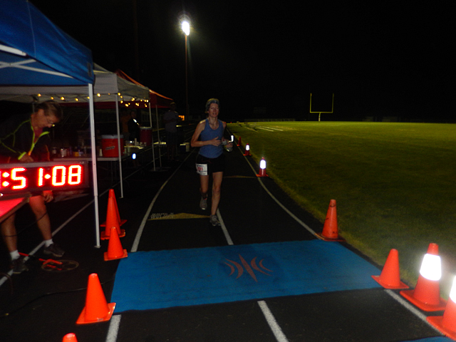 3:50 am... with runners orbiting the track at wildly varying speeds.