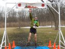 John Zalewski with His Traditional Leap at the Finish of Paleo-Camb 50-Km